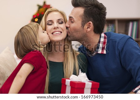 Portrait of affectionate family in christmas time  - stock photo