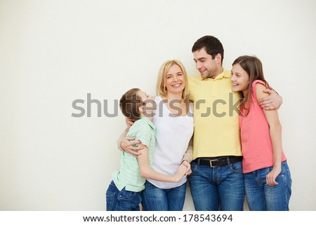 Portrait of affectionate family of four in isolation - stock photo
