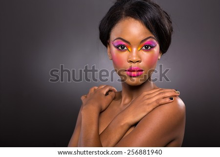 portrait of african american beauty on black background - stock photo