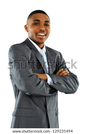 Portrait of African American businessman with arms crossed isolated over white background - stock photo