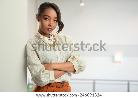 Portrait of African American businesswoman inside office building - stock photo