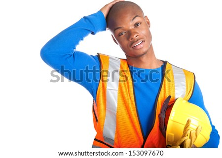 Portrait of African-American male construction worker holding hardhat - stock photo