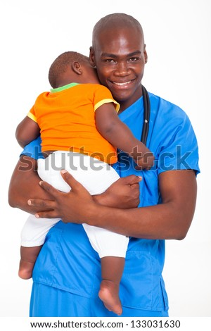 portrait of african american male pediatric doctor carrying a child - stock photo