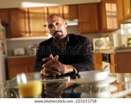 portrait of african american man in kitchen - stock photo