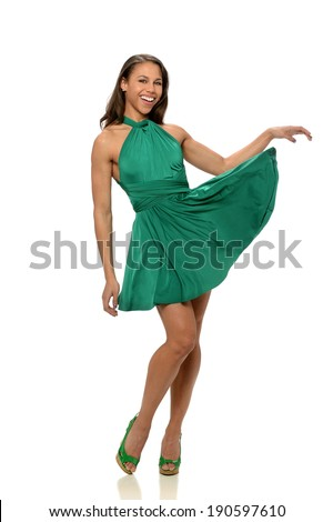 Portrait of African American woman in green dress isolated over white background - stock photo
