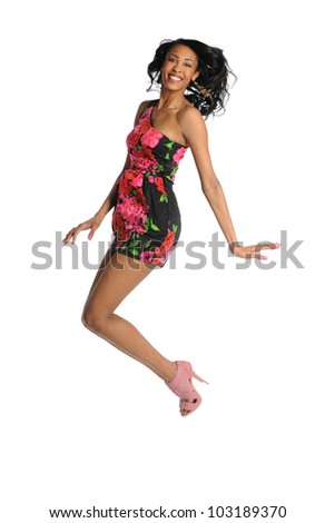 Portrait of African American woman jumping isolated over white background - stock photo