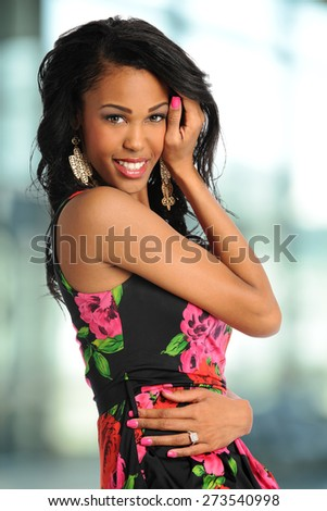 Portrait of African American woman smiling inside office building - stock photo