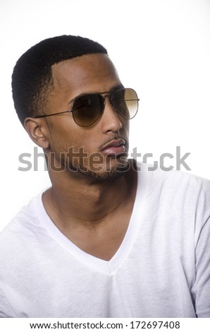 Portrait of African American young man wearing sunglasses - stock photo