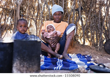 Portrait of African children and mother in the hut, location Mankodi village, Botswana - stock photo