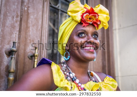 Portrait of african cuban woman looking at camera smiling - stock photo