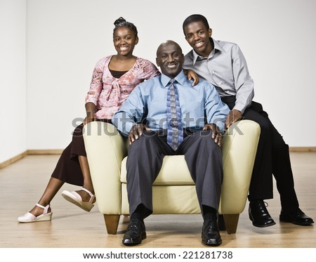 Portrait of African father and children - stock photo