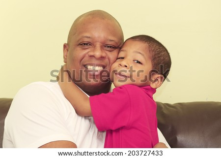 Portrait of african father and his son.  Focus in the kid.