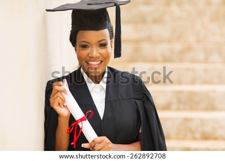 portrait of african female graduate standing outdoors - stock photo