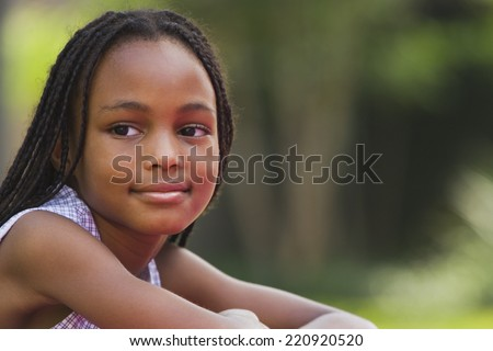 Portrait of African girl outdoors - stock photo