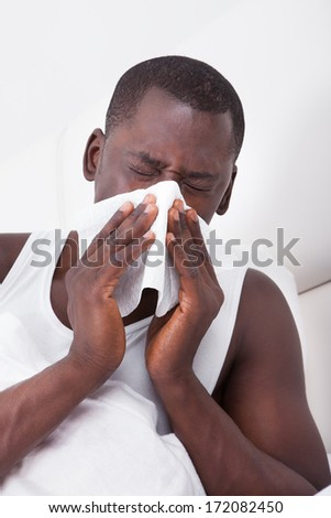 Portrait Of African Man Blowing His Nose In A Handkerchief - stock photo