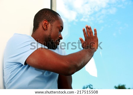 Portrait of african man looking at window