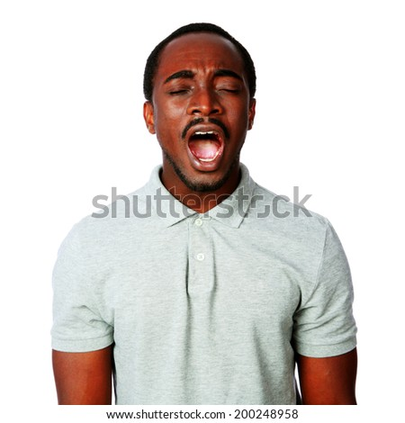 Portrait of african man shouting isolated on white background - stock photo