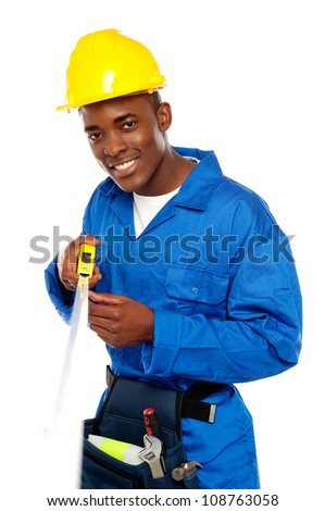 Portrait of african repairman with measuring tape isolated over white - stock photo