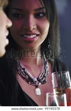 Portrait of African woman holding cocktail - stock photo