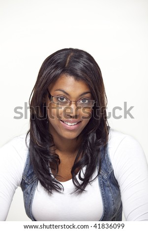 portrait of African woman smiling with glasses on white background - stock photo