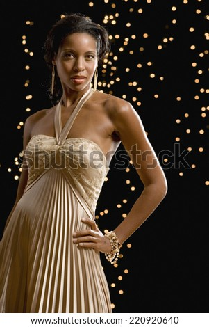 Portrait of African woman wearing evening dress - stock photo