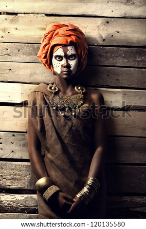 Portrait of African women against the background of the walls of boards. - stock photo