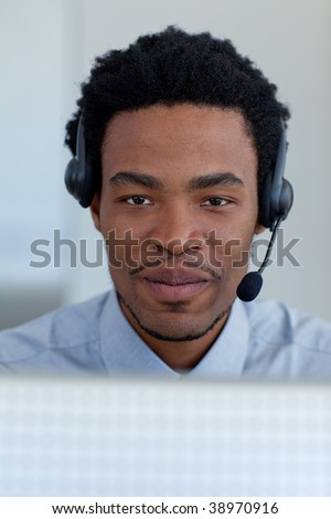 Portrait of Afro-American businessman working in a call center - stock photo
