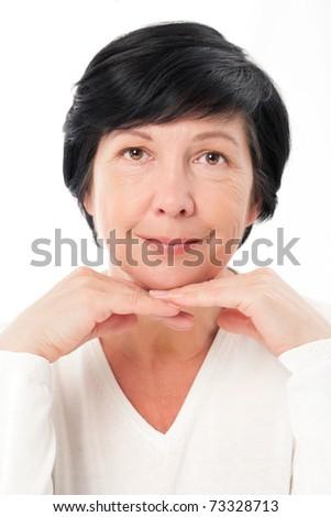 Portrait of aged beautiful woman on white - stock photo