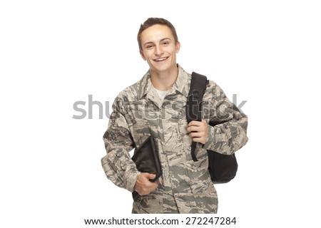 Portrait of air force airman college student with shoulder bag and digital tablet against white background - stock photo