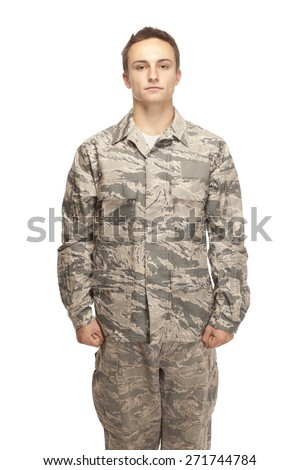 Portrait of air force airman standing at position of attention against white background - stock photo