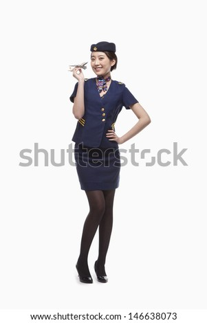 Portrait of Air Stewardess Holding Model Airplane
