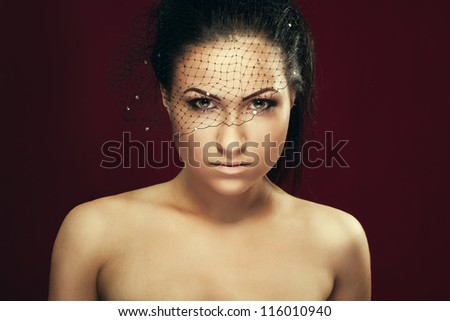 Portrait of alluring beautiful young women in veil closeup - stock photo