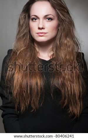 portrait of alluring woman over dark background - stock photo