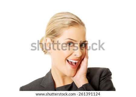 Portrait of amazed businesswoman holding hands on chin. - stock photo