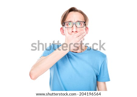 portrait of amazed man covering his mouth over white background - stock photo