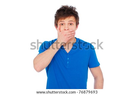 portrait of amazed man covering his mouth over white background
