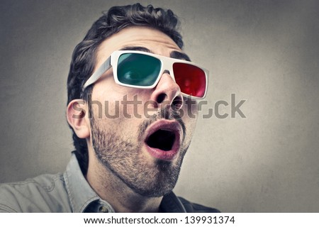 portrait of amazed man with 3d glasses - stock photo