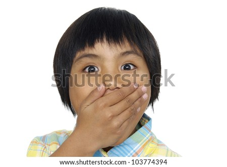 portrait of amazed small girl covering her mouth over white background - stock photo