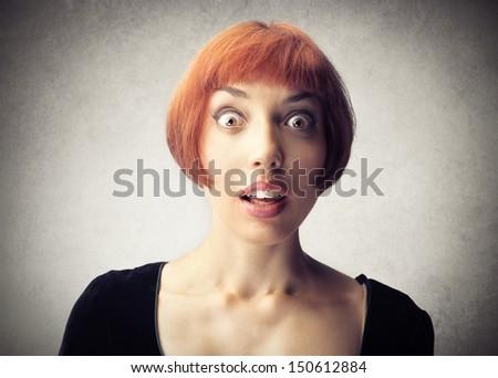 portrait of amazed woman - stock photo