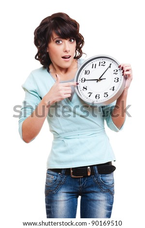portrait of amazed woman with clock over white background - stock photo