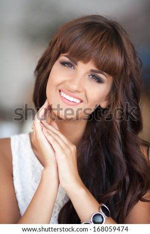 Portrait of amazing beautiful woman smiling outdoors.