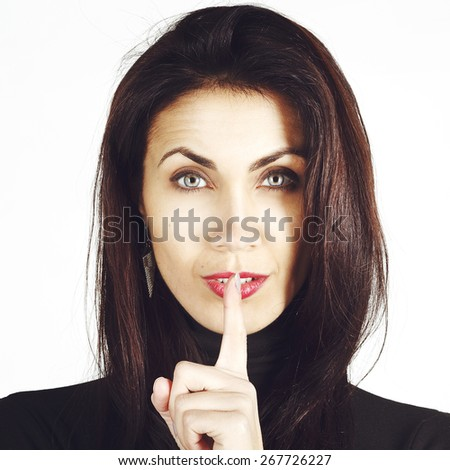 Portrait of amazingly sexy beautiful young brunette woman saying shh