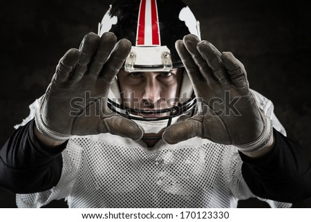 Portrait of american football player  - stock photo