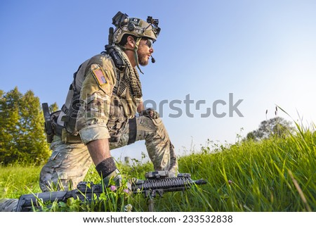 Portrait of American Soldier on blue sky background - stock photo