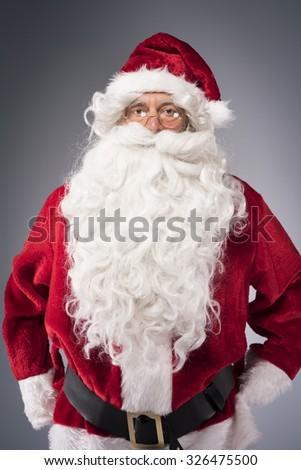 Portrait of amicable Santa Claus - stock photo
