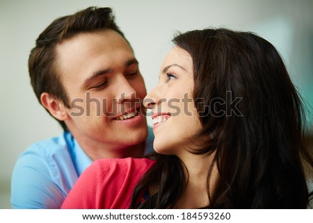 Portrait of amorous young couple looking at one another - stock photo
