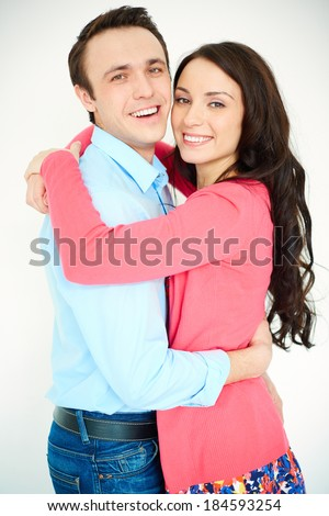 Portrait of amorous young woman and man embracing