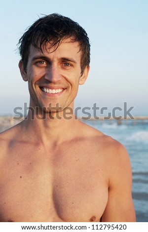 portrait of an active young man at the beach - stock photo