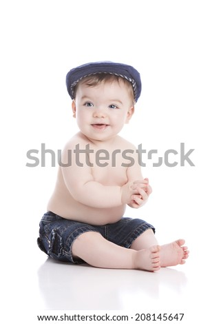 Portrait of an adorable baby boy.  Isolated on white.