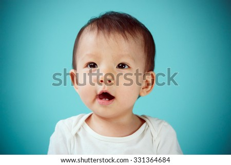 Portrait of an adorable baby girl (soft focus on the eyes) - stock photo